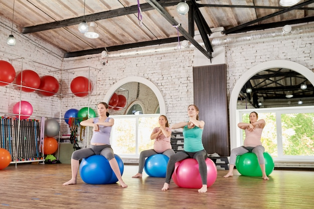 Group of pregnant women doing fitness