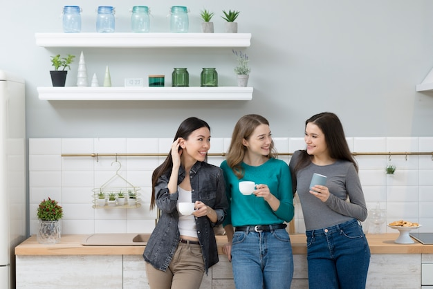 Group of pretty young women having coffee together