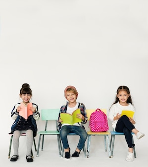 A group of primary schoolers studying