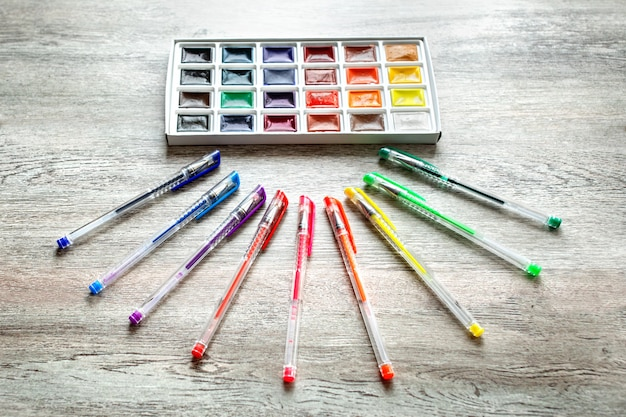 A group of products for drawing and creativity on wooden table.