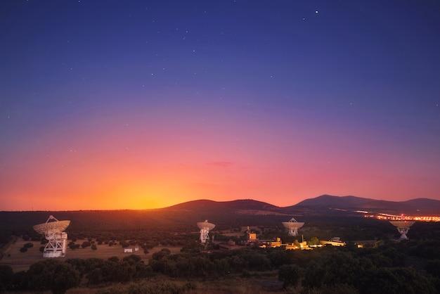 Group of radio telescopes at sunset