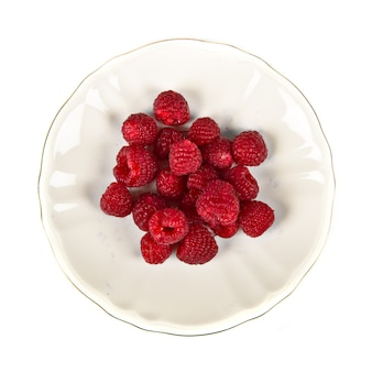 Group of raspberries over isolated white background