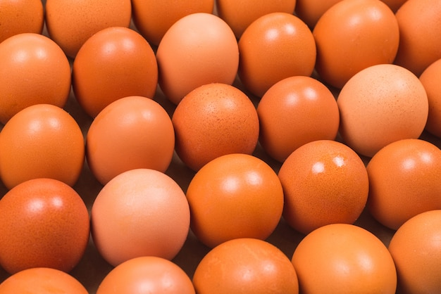 Group of raw brown eggs