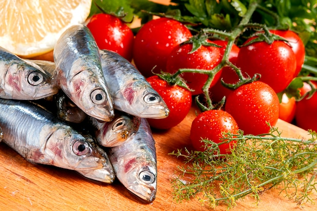 Group of raw sardines on a cutting board