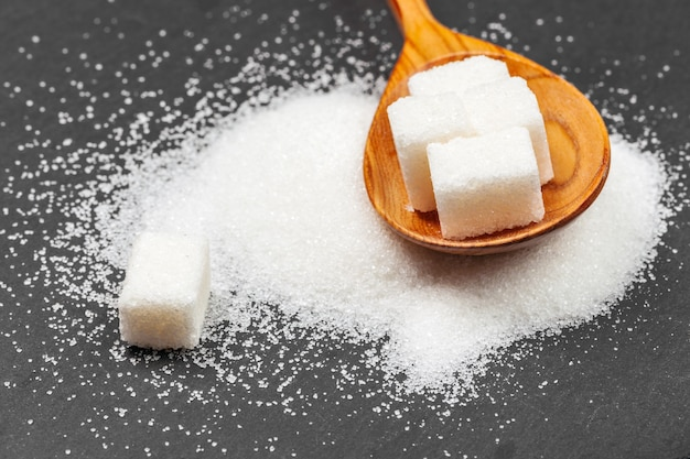 Group of refined white sugar cubes close up