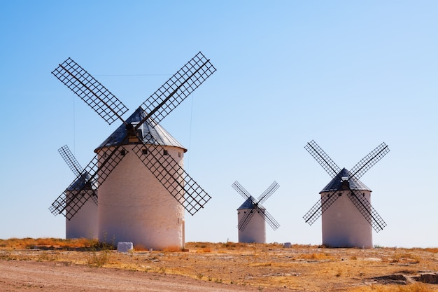 Group of retro windmills in field