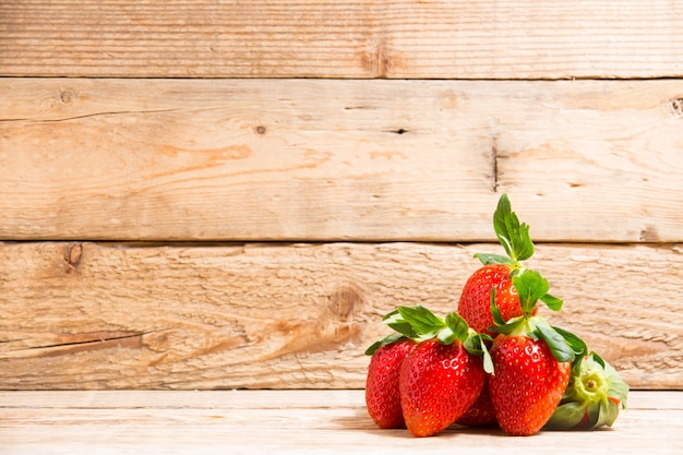 Group ripe red strawberry on wooden table