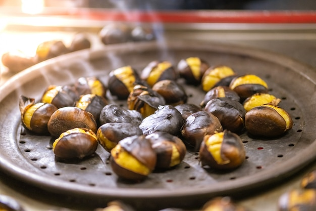 Group of roasted chestnuts for sale on the street