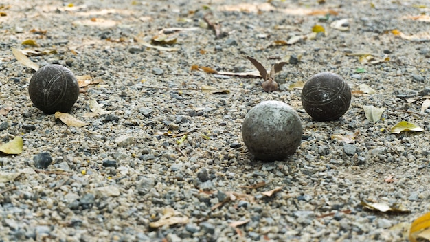 Group of rusted and dirty metallic or steel used petanque ball