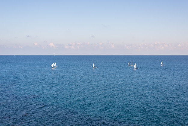 Group of sailing boats on the blue mediterranean sea