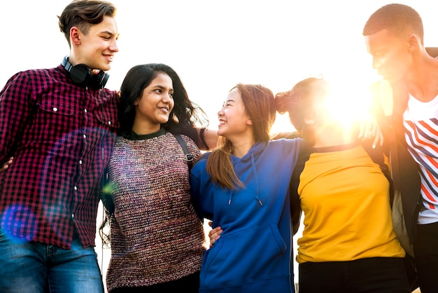 Group of school friends outdoors arms around one another