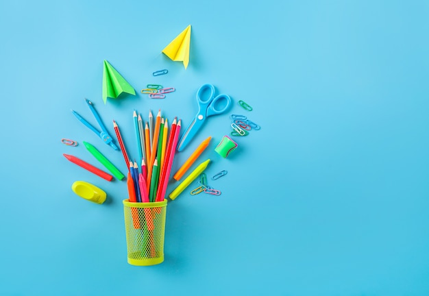 Group of school supplies on blue