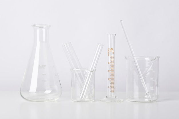 Group of scientific laboratory glassware with clear liquid solution, science research and development concept.