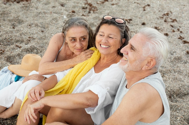 Group of senior friends spending time together at the beach