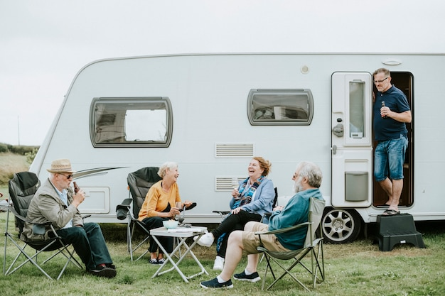 Group of senior people gathering outside a trailer