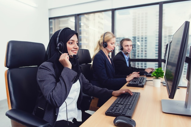 Group of service desk consultant customer service staff talking on headset working in call center