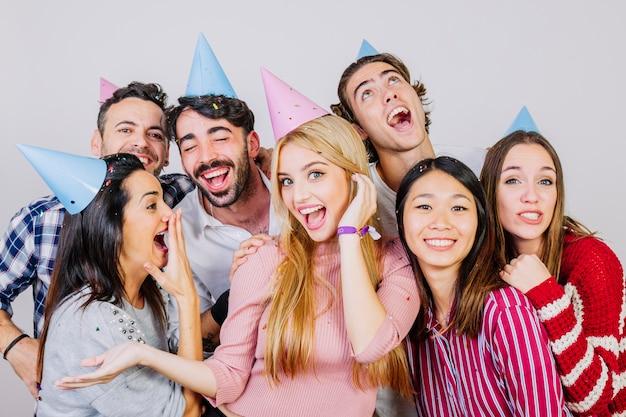 Group of seven good friends celebrating birthday