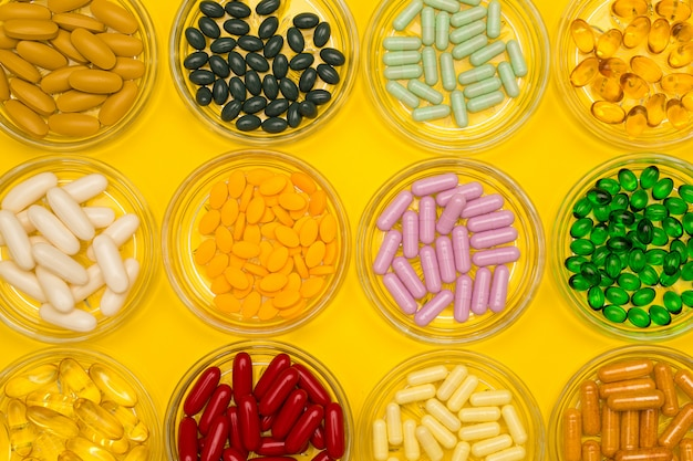 Group of several sizes of pills in glass