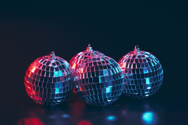 Group of shiny disco balls on dark background close up