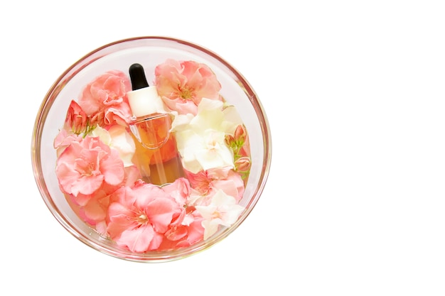Group of skincare serum oil with little flowers in glass plate. facial beauty cosmetic spa product. natural cosmetology concept skin treatment. dropper of essential oil, aromatherapy