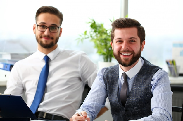 Group of smiling bearded businessmen in suit and tie
