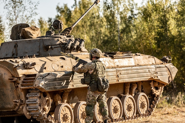 Group of soldiers on tanks on the outdoor on army exercises. war, army, technology and people concept