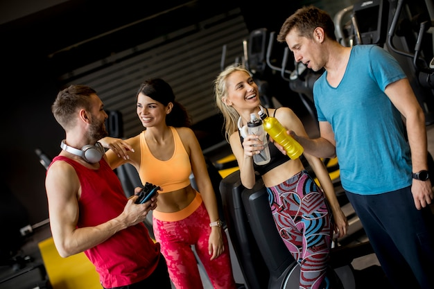 Group of sporty young people at the gym