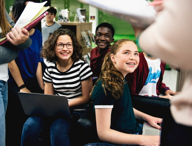 A group of students listening in the library