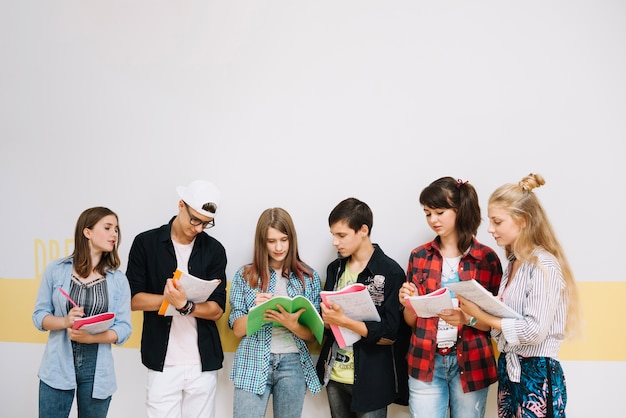 Group of students posing with notepads