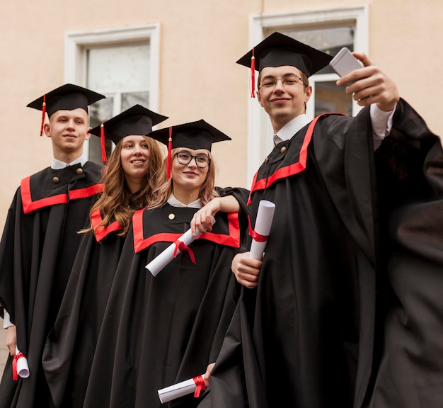 Group of students taking photos