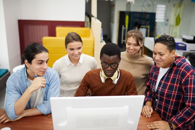 Group of students using internet in library