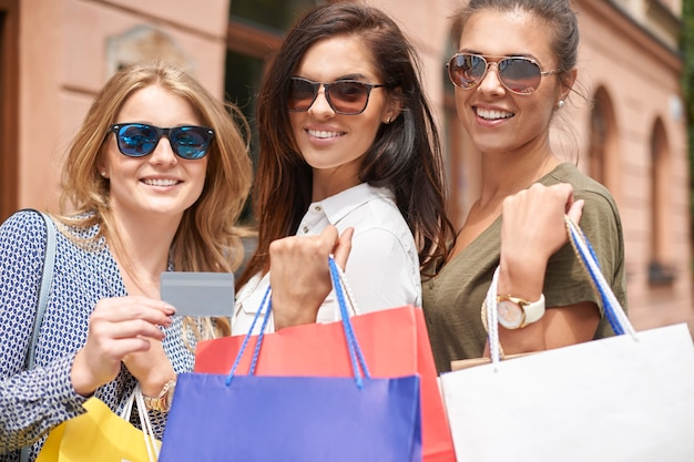 Group of stylish women going shopping