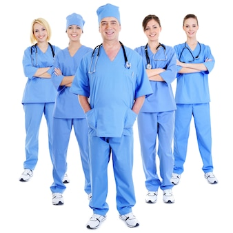 Group of successful laughing surgeons in blue uniforms on white