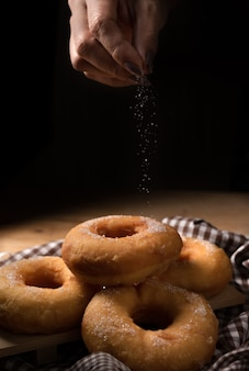 Group of sugar donuts on table