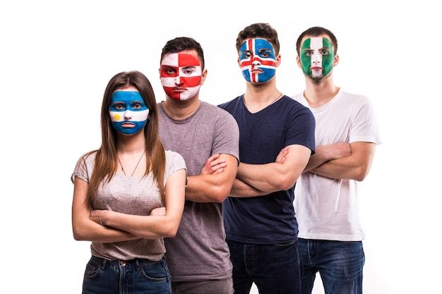 Group of supporter of argentina, croatia, iceland, nigeria national teams fans with painted face isolated on white background