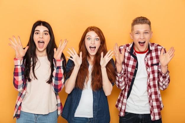 Group of surprised school friends screaming