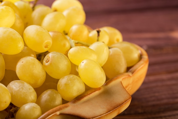 Group of tasty fresh green grapes close up in a bowl