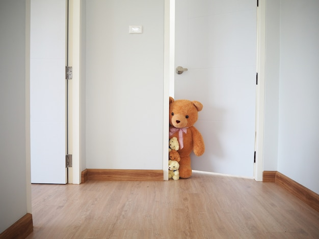 A group of teddy bears standing inside the house.