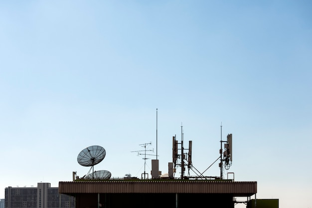 Group of telecommunication antennas and satellite dish