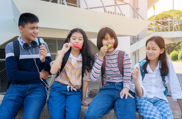 Group of thai students eating ice cream ice-cream sitting at campus