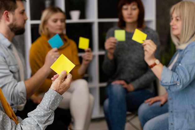 Group therapy session with sticky notes