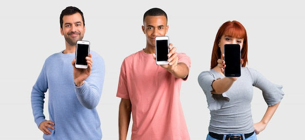 Group of three friends using mobile phone