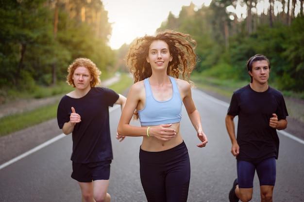 Group of three people running