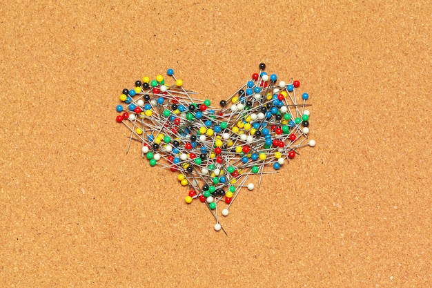 Group of thumbtacks  on corkboard close up. school or business concept