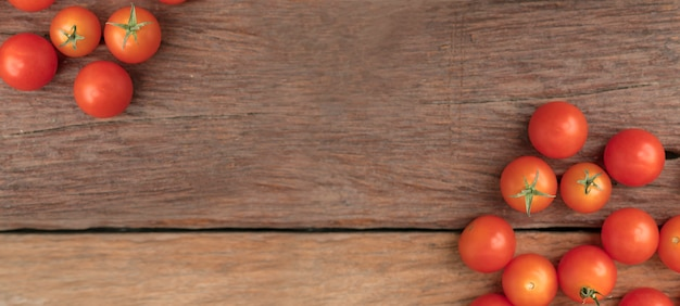 Group tomato place on the wooden table use for background