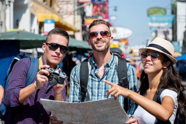 Group of tourist backpacker friends traveling in bangkok thailand on vacations