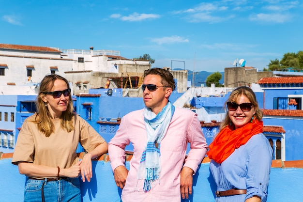 Group of tourists in the famous blue city.