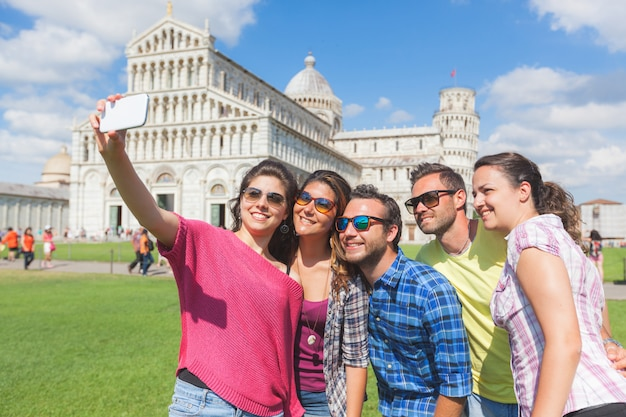 Group of tourists taking a selfie in pisa.
