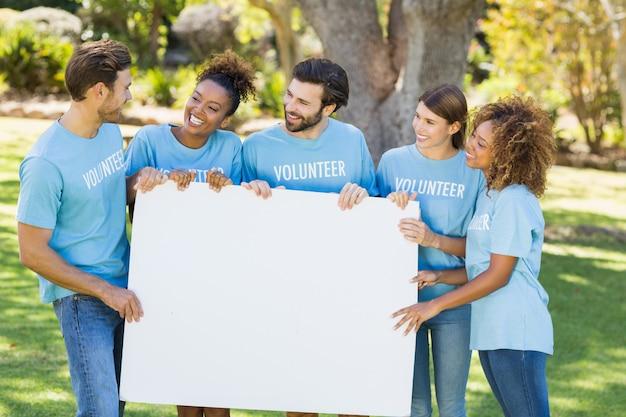 Group of volunteer holding blank sheet