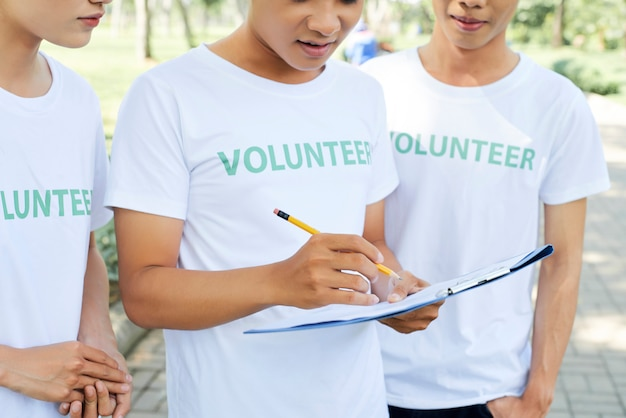 Group of volunteer with clipboard outdoors